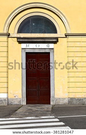 door italy  lombardy     in  the milano old   church   closed brick     pavement
