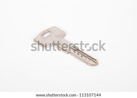 Door key, isolated on white background. - stock photo