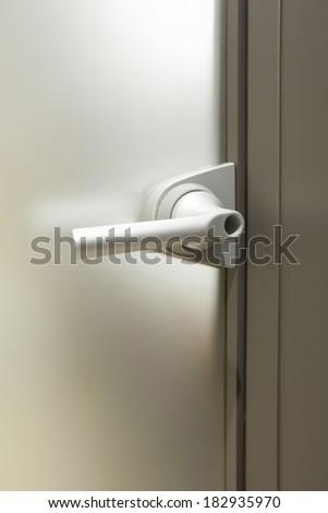 Door knob on glass door - stock photo