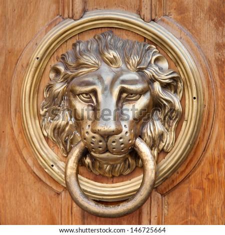 Door knocker, handle -  lion head - stock photo