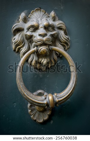 Door knocker, handle - lion head at Lucca, Tuscany. Italy - stock photo
