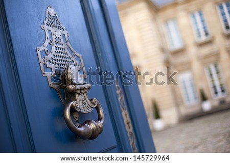 Door knocker of a mansion in France - stock photo