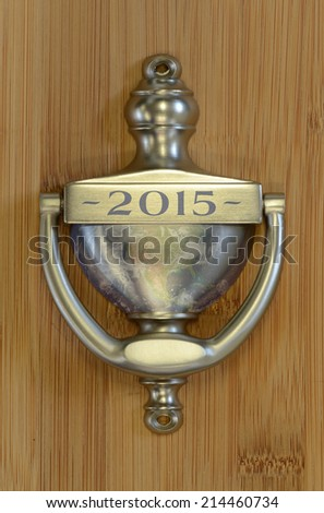 """Door knocker with the number 2015 on it, useful for New Years - """"Elements of this image have been furnished by NASA"""" - stock photo"""