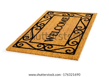 Door Mat: Friendly Welcome Door Mat - stock photo