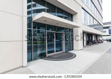 Door of a new contemporary office building - stock photo