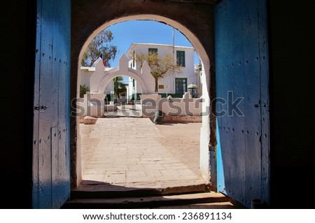 Door of church seen from inside in San Pedro de Atacama, Chile - stock photo
