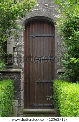 Door of medieval catholic church in Brussels, Belgium
