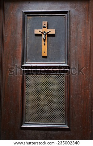 Door of room for confession in Catholic Church - stock photo