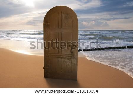 Door on the beach - stock photo