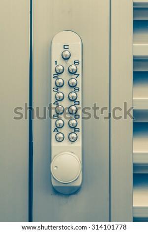 Door pin keypad with numbers and metal door - stock photo