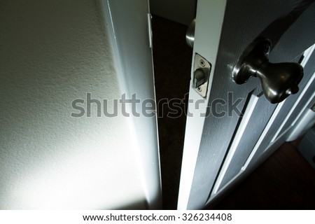 Door that opens into the unknown or maybe hell? - stock photo