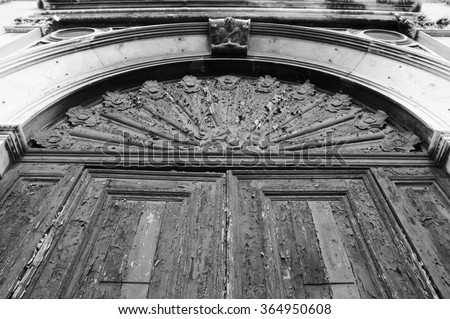 Door with peeling paint. Venice (Italy). Aged photo. Black and white. - stock photo