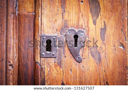 Door with two locks, one heart shaped