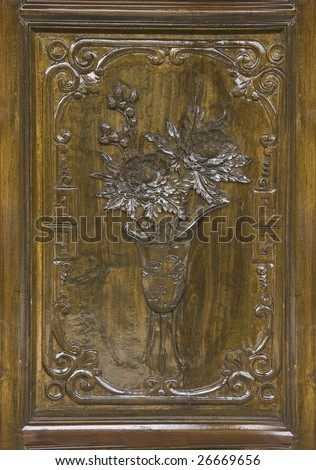 door with wood carvings - stock photo