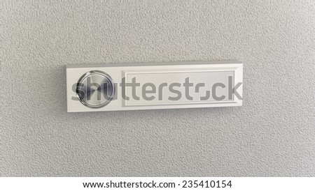 Doorbell on concrete wall with empty nameplate. Conceptional image with copy space for own ideas - stock photo