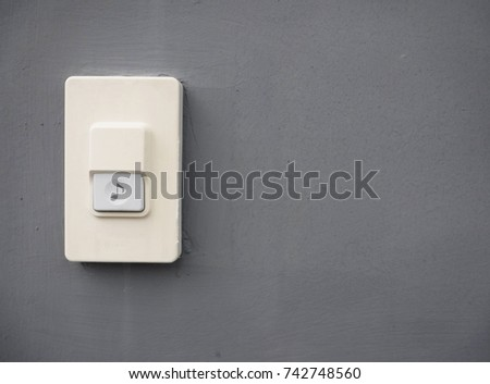 doorbell or buzzer on gray wall