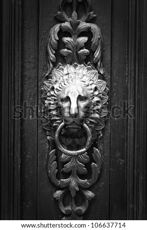 doorknocker like lion head  black and white - stock photo