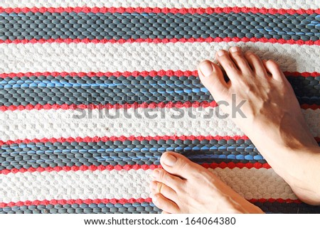 Doormat and foots - stock photo