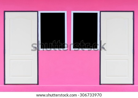 doors and windows on pinks wall - stock photo