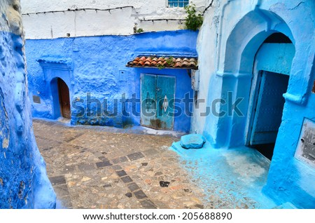 Doors on narrow street in medina of blue town Chefchaouen in Morocco - stock photo