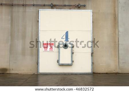 Doors to cold storage warehouse with warning signs, Wenatchee Washington. - stock photo