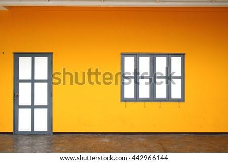 doors, windows White Orange wall And the brown - stock photo