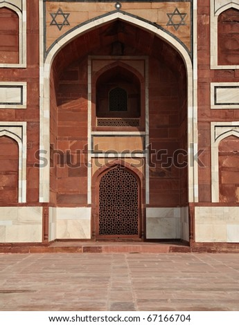 Doorway at the entrance gate to the Taj Mahal - stock photo