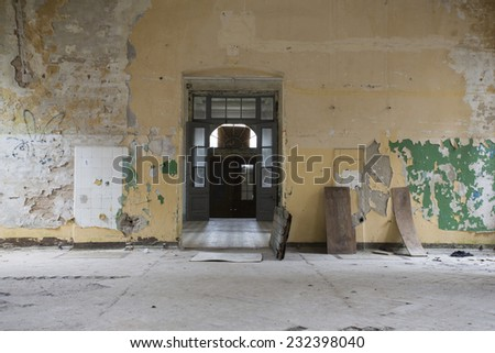 doorway entrance into long dark corridor  - stock photo