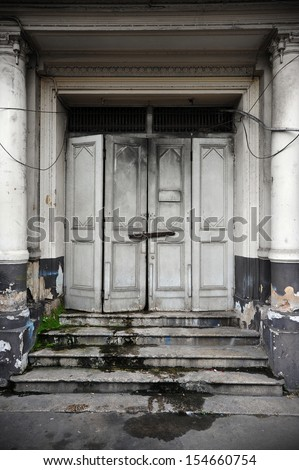Doorway of an Old Derelict Building - stock photo