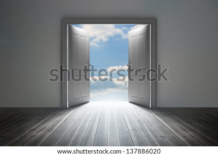 Doorway revealing bright blue sky in dull grey room - stock photo