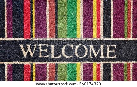 Doorway rug or doormat, welcome, natural fibers, background, toned image - stock photo