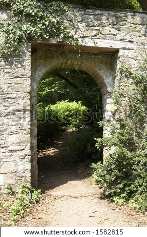 doorway through to a lush green garden - stock photo