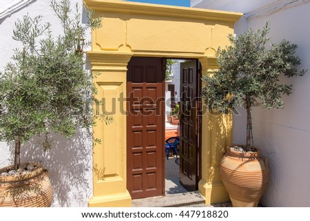 Doorway to a courtyard of greek house in Lindos. Island of Rhodes, Greece - stock photo