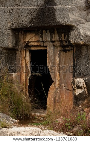 Doorway to rock cut tomb in Myra Turkey - stock photo