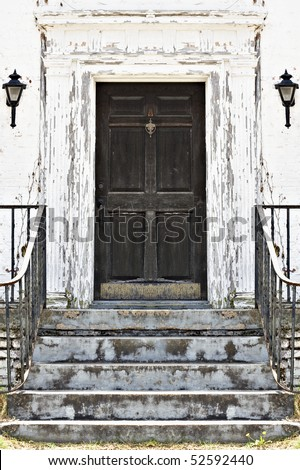 Doorway to run down old home with chipped paint - stock photo
