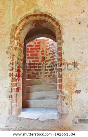 Doorway to the stairs inside medieval castle in Cesis, Latvia - stock photo