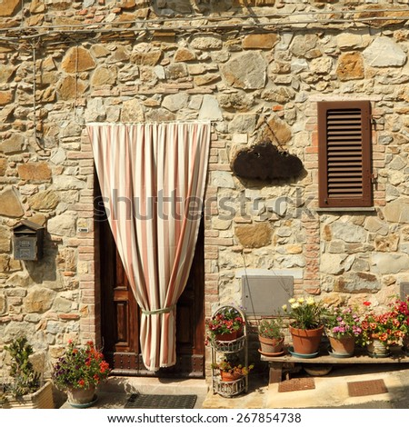doorway to the tuscan house with striped door curtain , Italy, Europe - stock photo