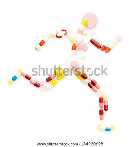 Doping drugs and pills in the shape of an athletic runner on track. - stock photo