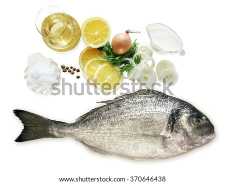 Dorado fish and ingredients for its preparation - stock photo