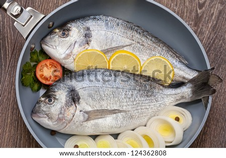 Dorado fish prepared for baking - stock photo