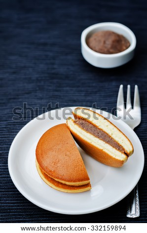 dorayaki, Japanese red bean pancakes on a black background. toning. selective focus