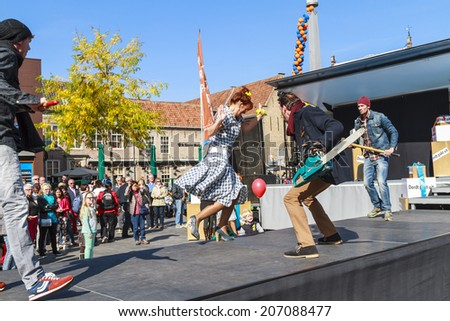 DORDRECHT, NETHERLANDS - SEPTEMBER 29 2013: Free entertainment and fashion show in the main square organized by the municipality. Male models entertain on the catwalk showcasing the autumn collection.