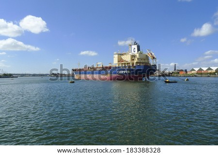 Dordrecht, The Netherlands - August 31, 2013: Clipper Mari, a chemical and oil products tanker anchored in the Wilhelmina harbor in Dordrecht. She sails under the Bahamas flag and was built in 2010.