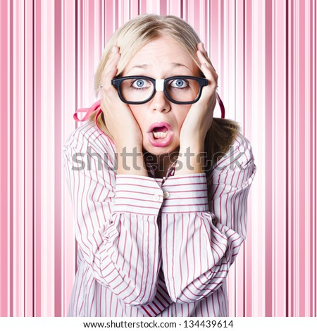 Dorky woman wearing spectacles clutching head with look of panic when making a difficult business decision
