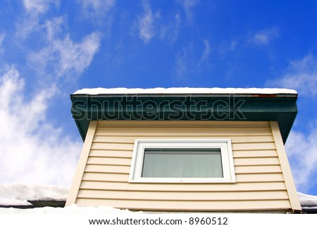 Dormer of our house against a blue sky - stock photo