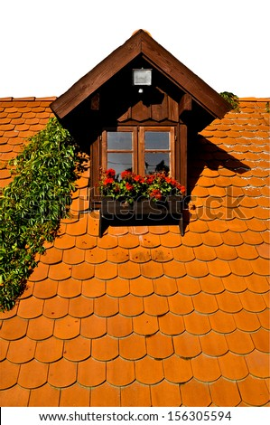 Dormer window view with geranium flowers - sky isolated - stock photo