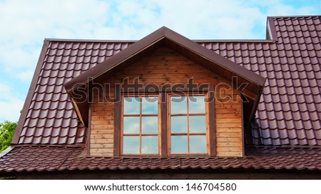Dormer windows and roof of red tiles - stock photo
