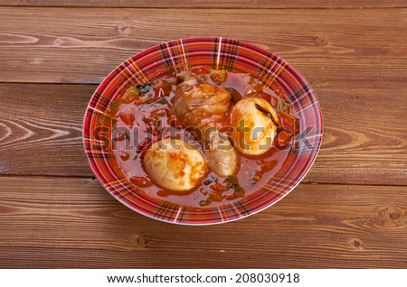 Doro Wat - Ethiopian red chicken stew wat is one such stew, made from chicken and sometimes hard-boiled eggs. - stock photo