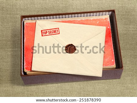 dorsal view of military message and other documentation on military background with path - stock photo