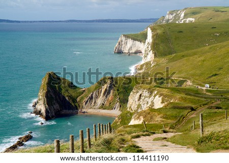 Dorset coastline looking towards Durdle Door, the route of the South-West coastal path - stock photo